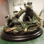 Coubtry Artists Badger and 2 Cubs surrounded by Logs and Moss Figurine